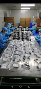 Workers assembling face shields